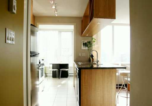 Modern yaletown condo kitchen den