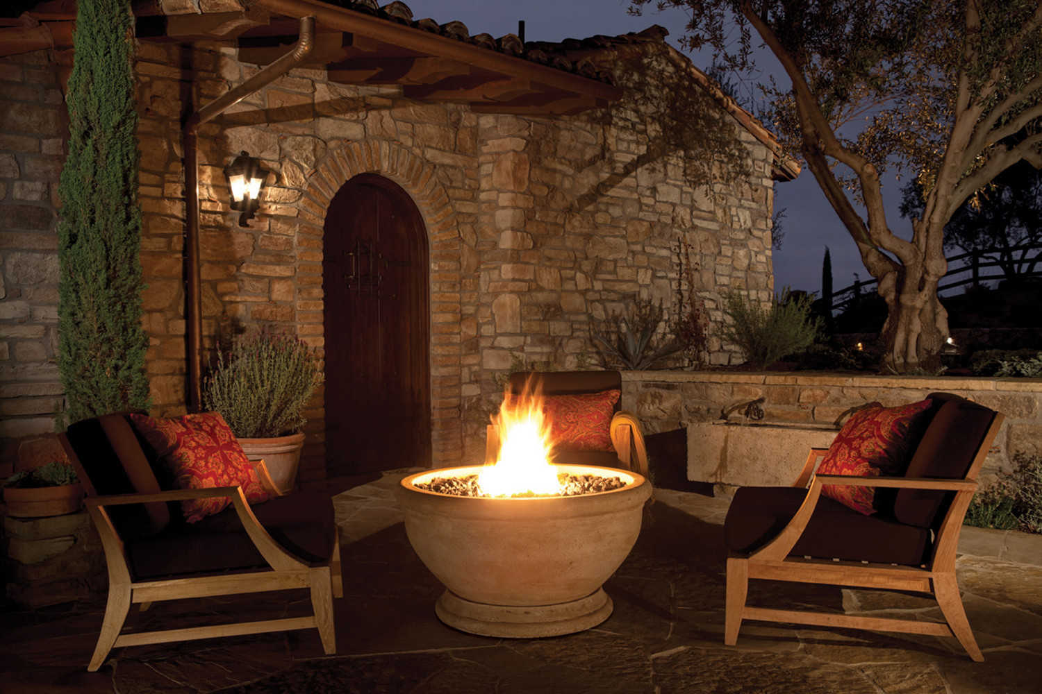 eo marbella fire bowl oak barrel travertine ext night