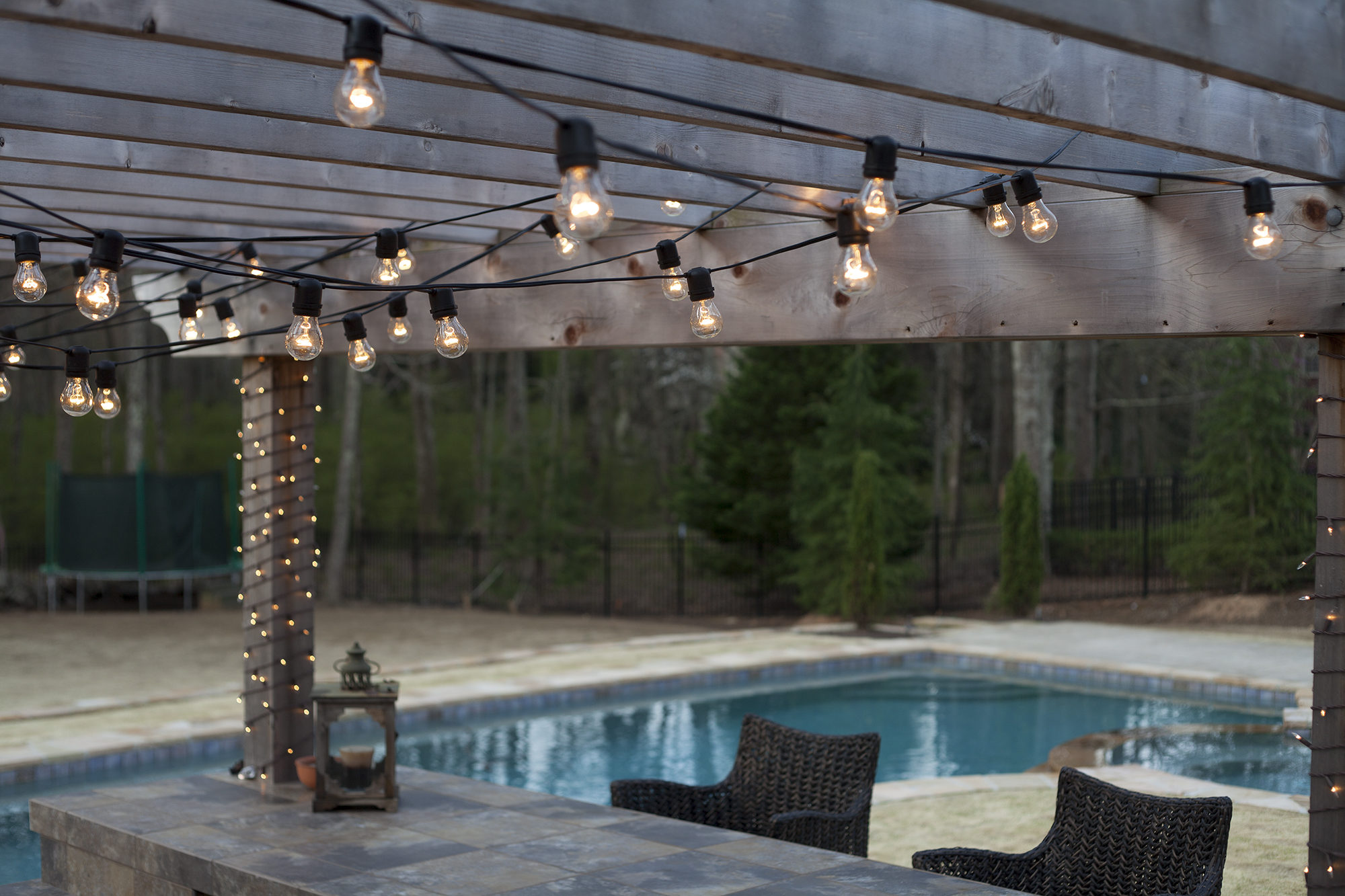 fabulous patio string lights with vintage bulbs for your pool party with combination of zig zag and crossove x pattern