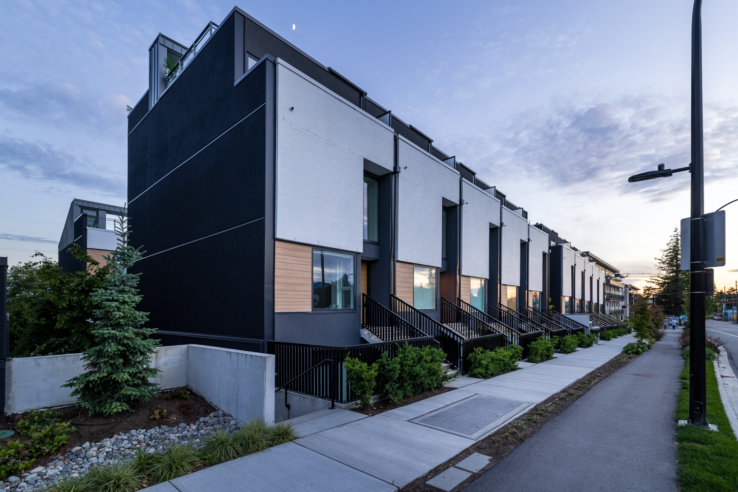 40 thoughtfully designed modern townhouses and garden suites, each with own front door Dististince London-Inspired West Coast Modern Design by Shape Architecture, accented with white brick, grey metal detailing and cedar finishes