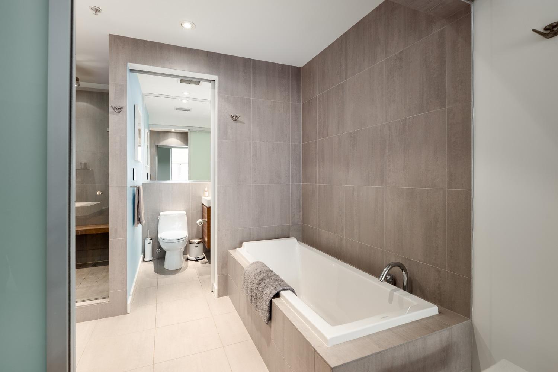 designer washroom with high end fixtures and floating vanity - Vancouver Loft for sale