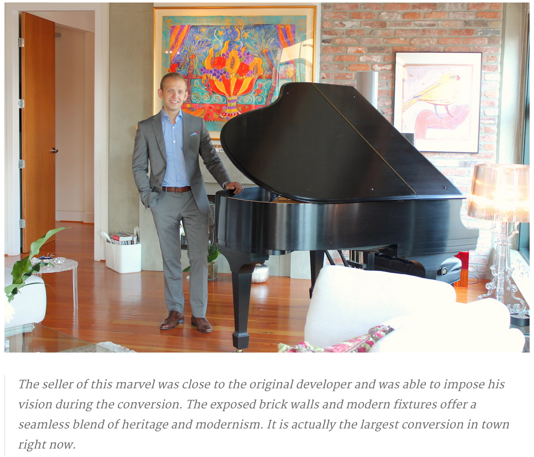 paul albrighton stands by the grand piano at 1180 homer street   vancouvers finest loft at 46m
