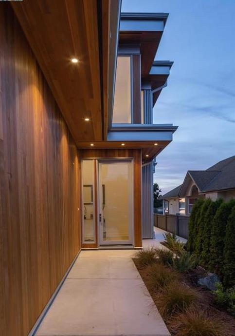 Clear Coated Cedar and Metal Detail work on this modern home located on the beach